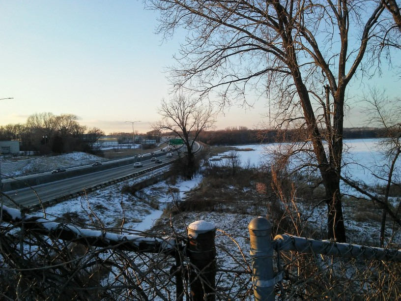 freeway, lake, chain link fence in winter