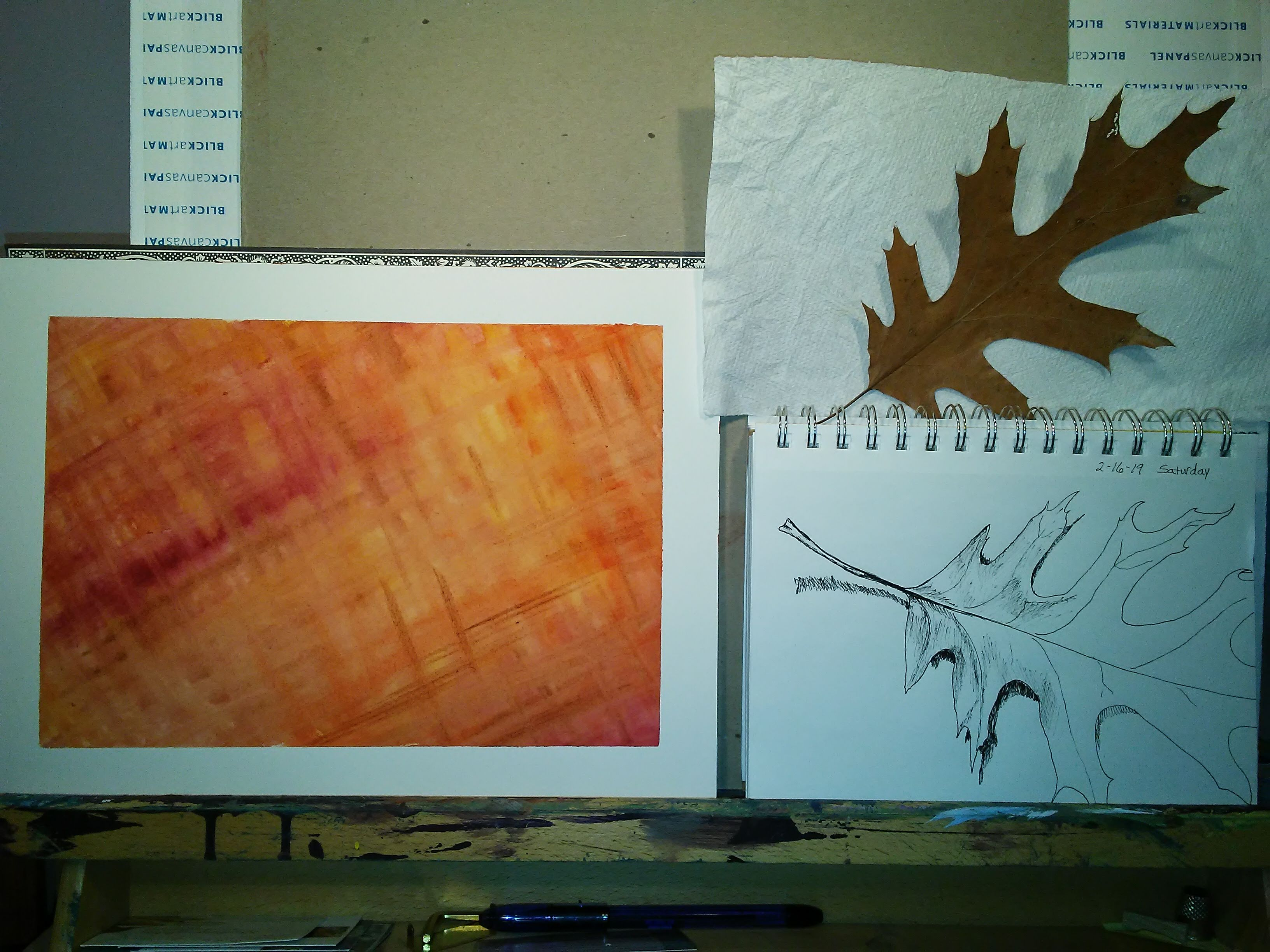 leaf, sketch, and orange painting on an easel