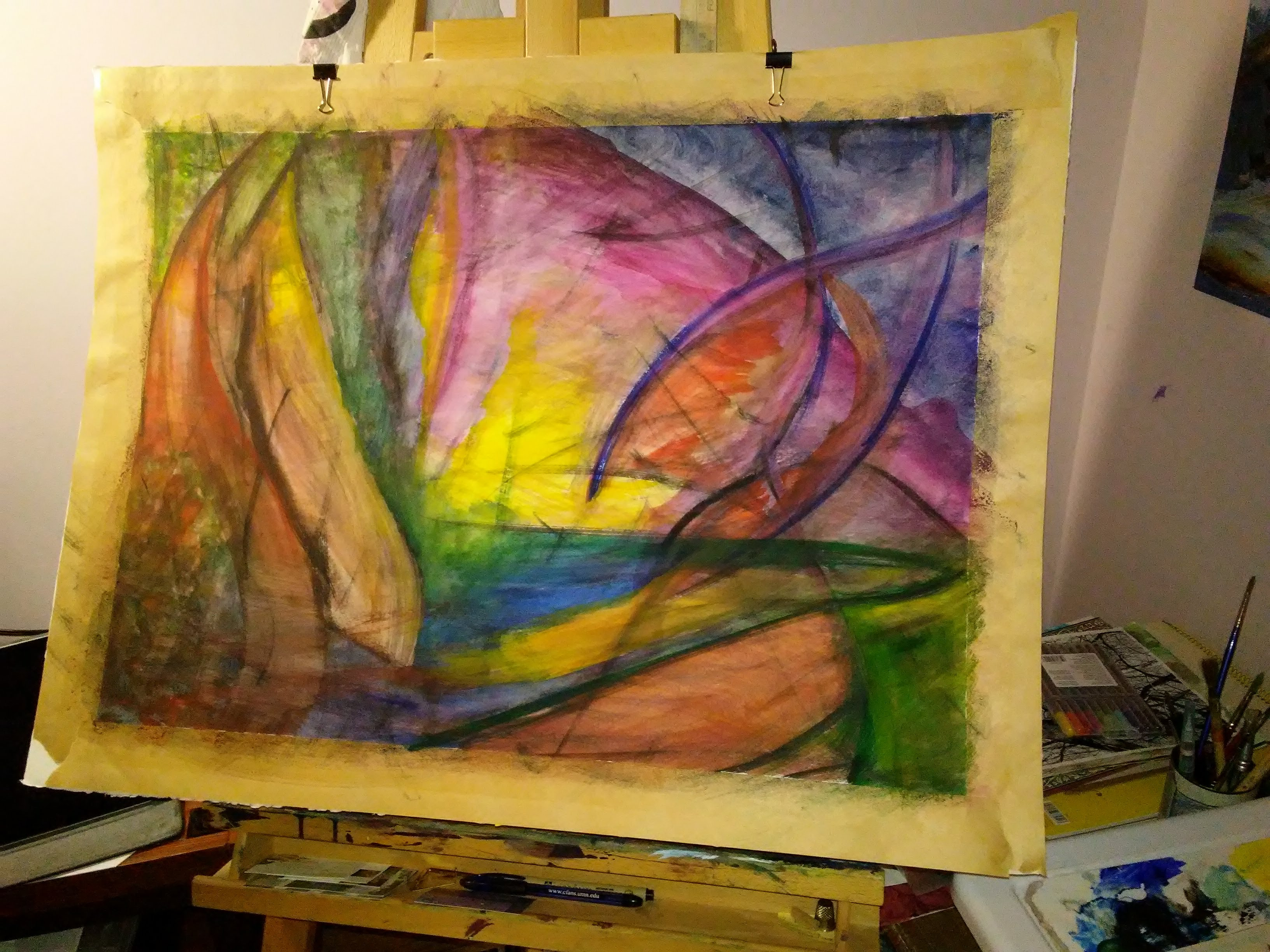 painting on an easel. Abstract shapes and bright colors.