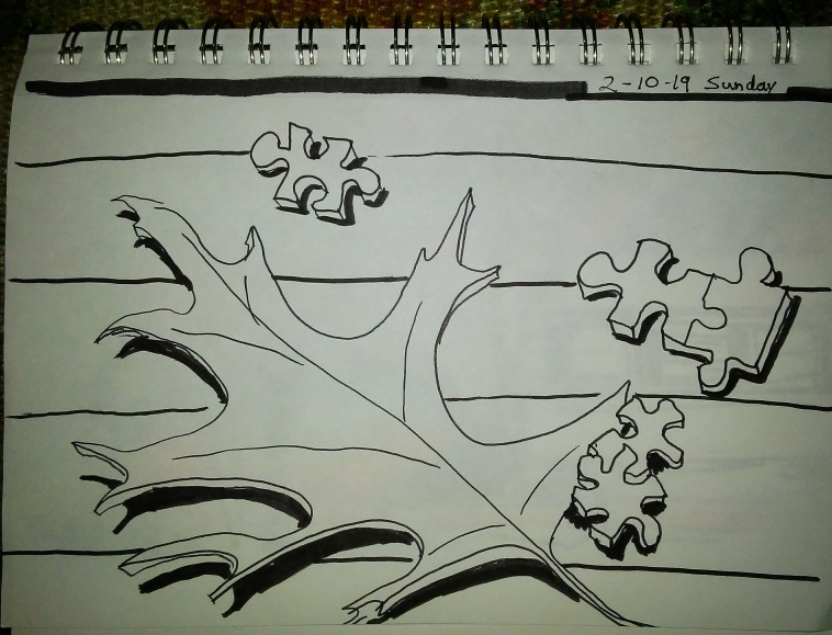 drawing in spiral notebook of a leaf and jigsaw puzzle pieces.