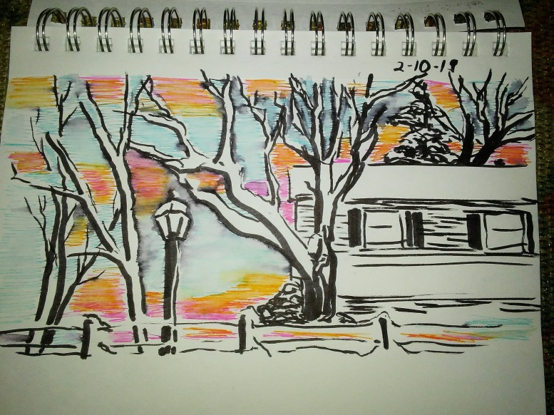 drawing in spiral notebook of trees and a house and a lightpost.