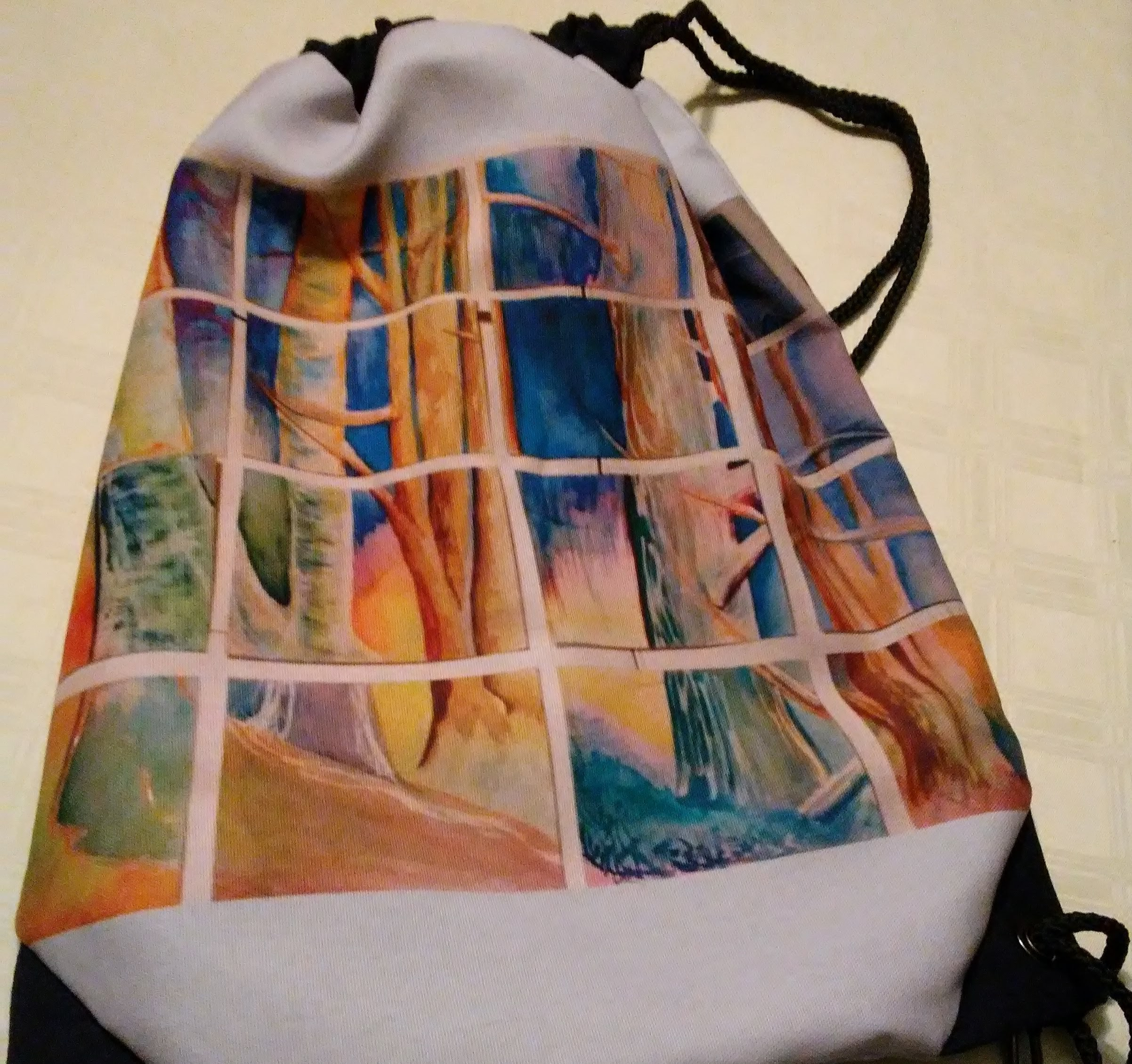 Grid of Trees painting printed on a drawstring bag