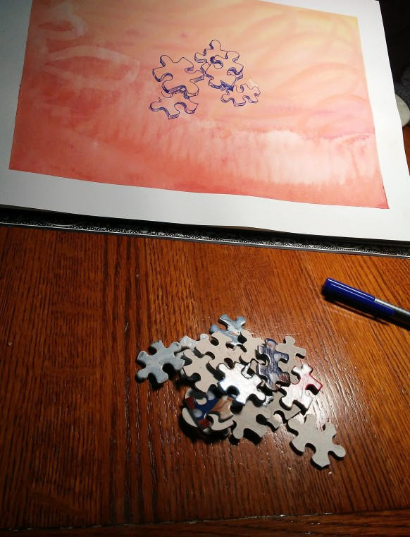 jigsaw puzzle pieces and a drawing of jigsaw puzzle pieces