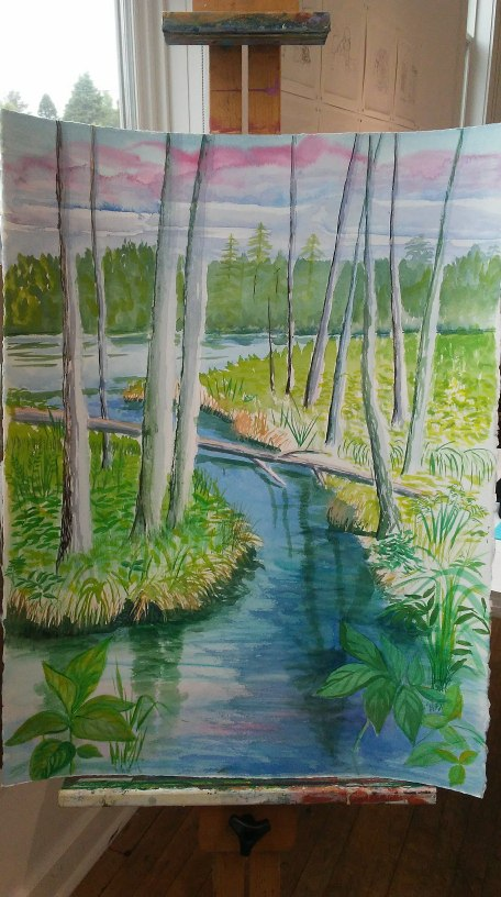 Painting of water and trees on an easel