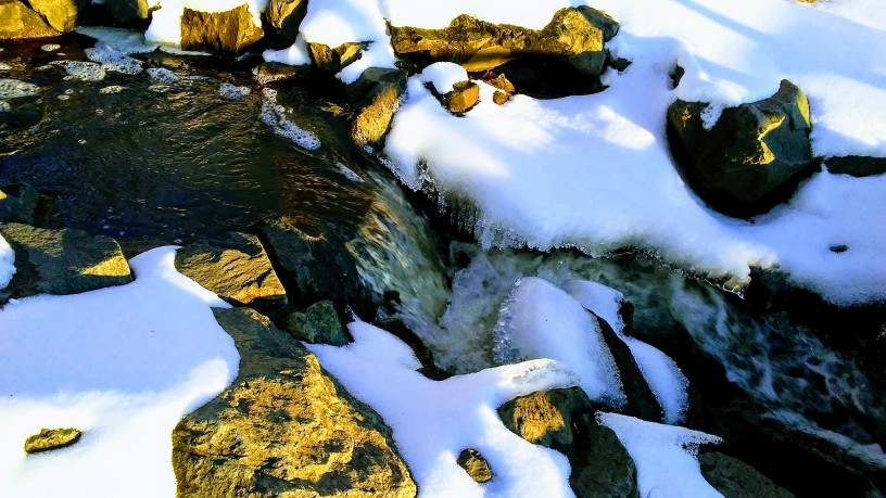 tan rocks, snow, water.