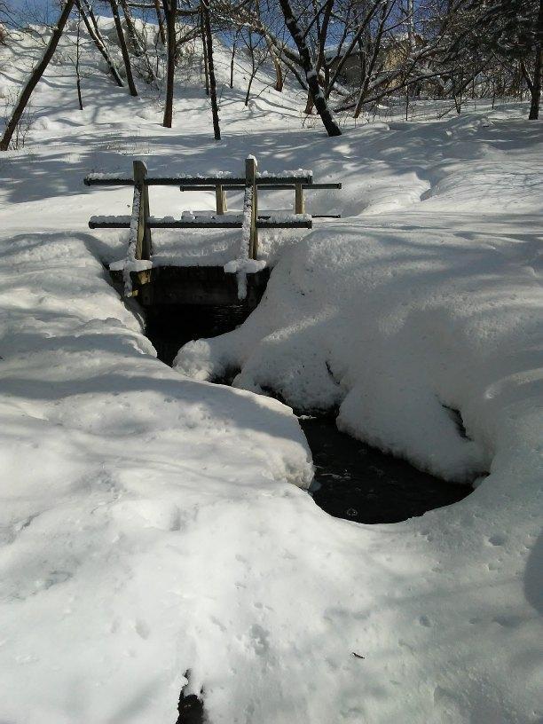 bridge over a small creek. Deep snow.