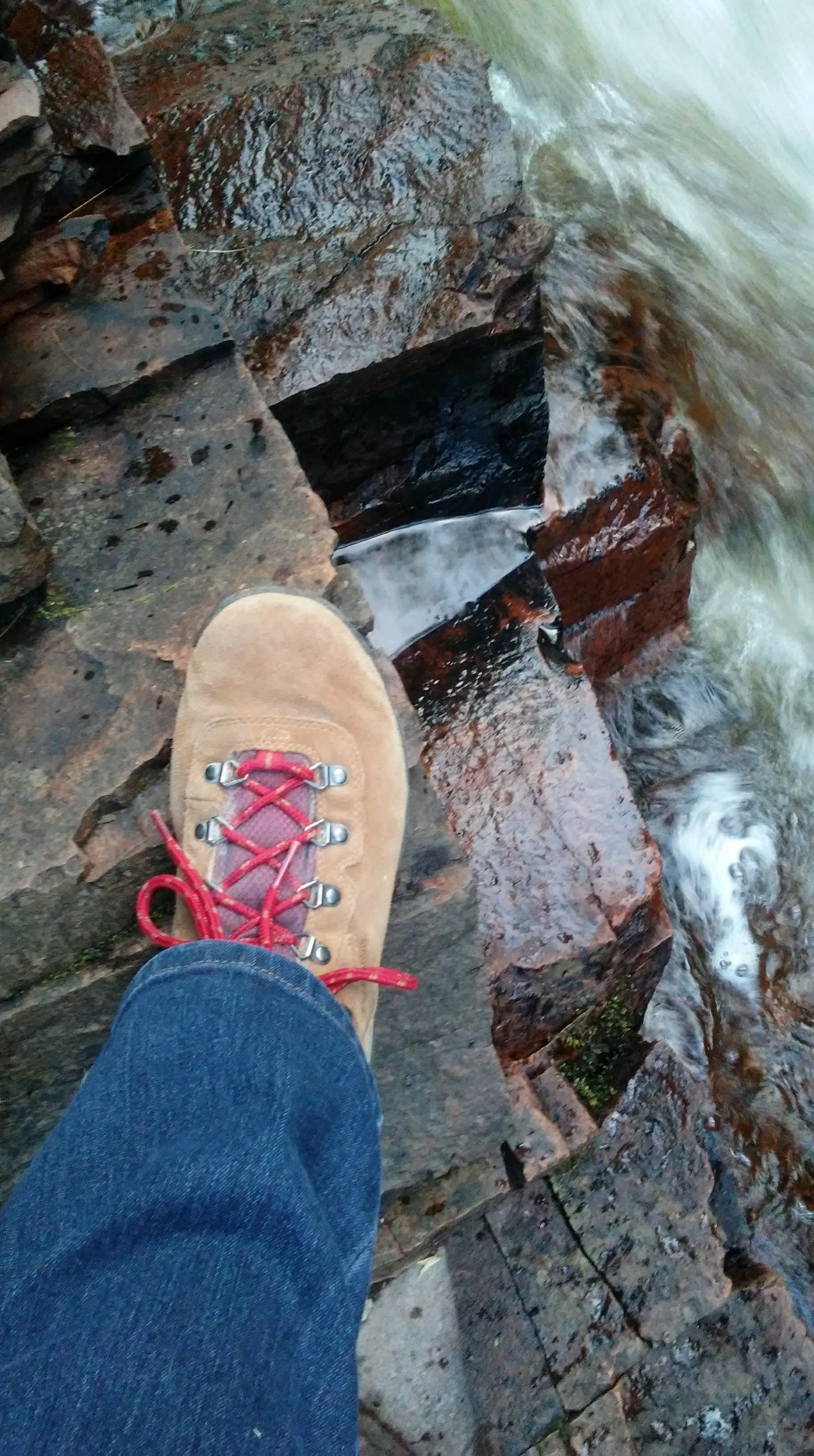 hiking boot and rocks and water