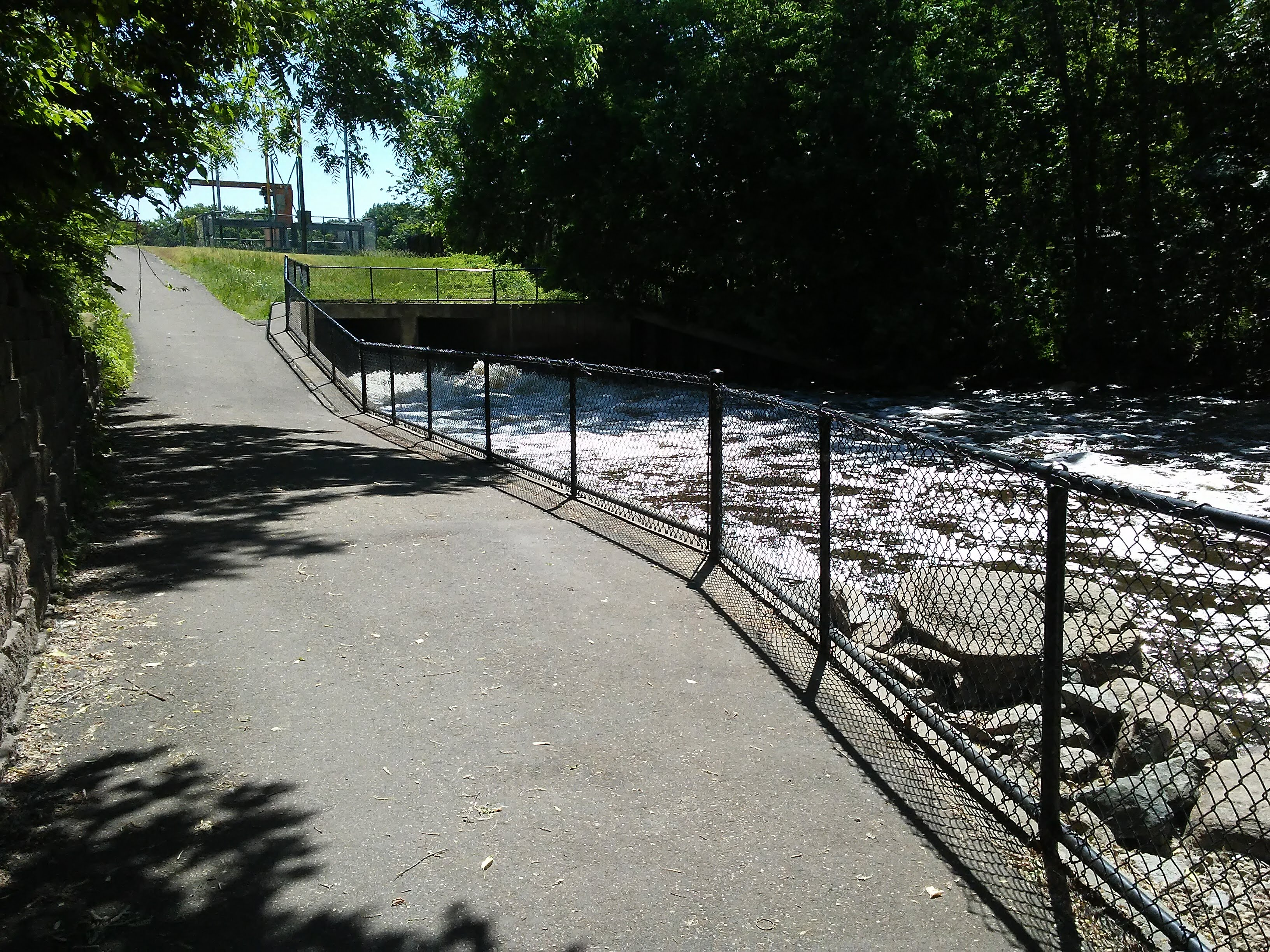 paved path, fence, stream, industrial structure