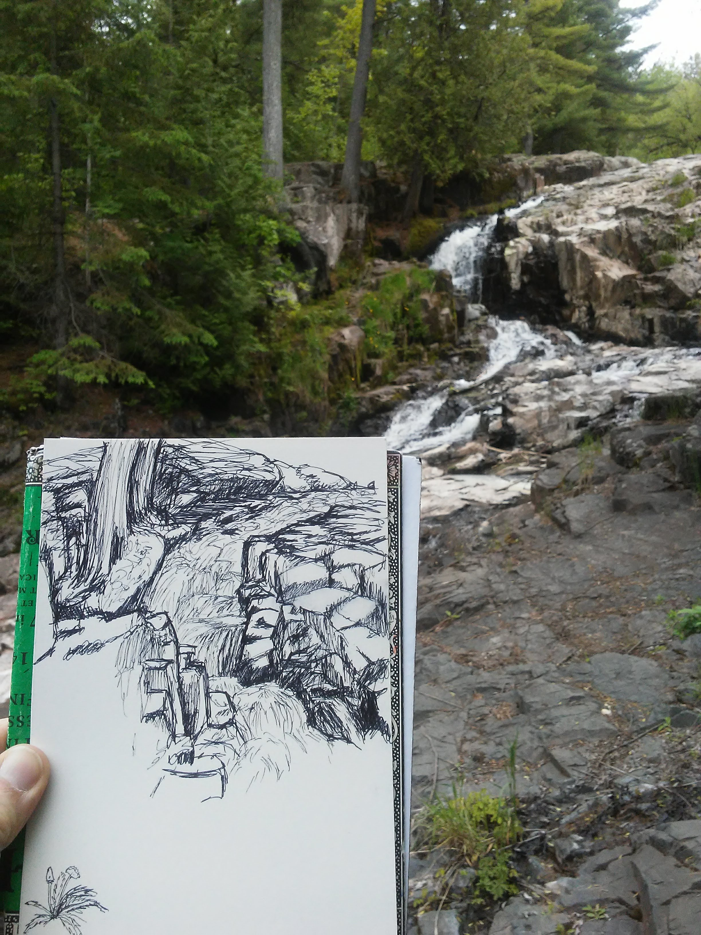 sketch of a waterfall in the foreground and the waterfall in the background