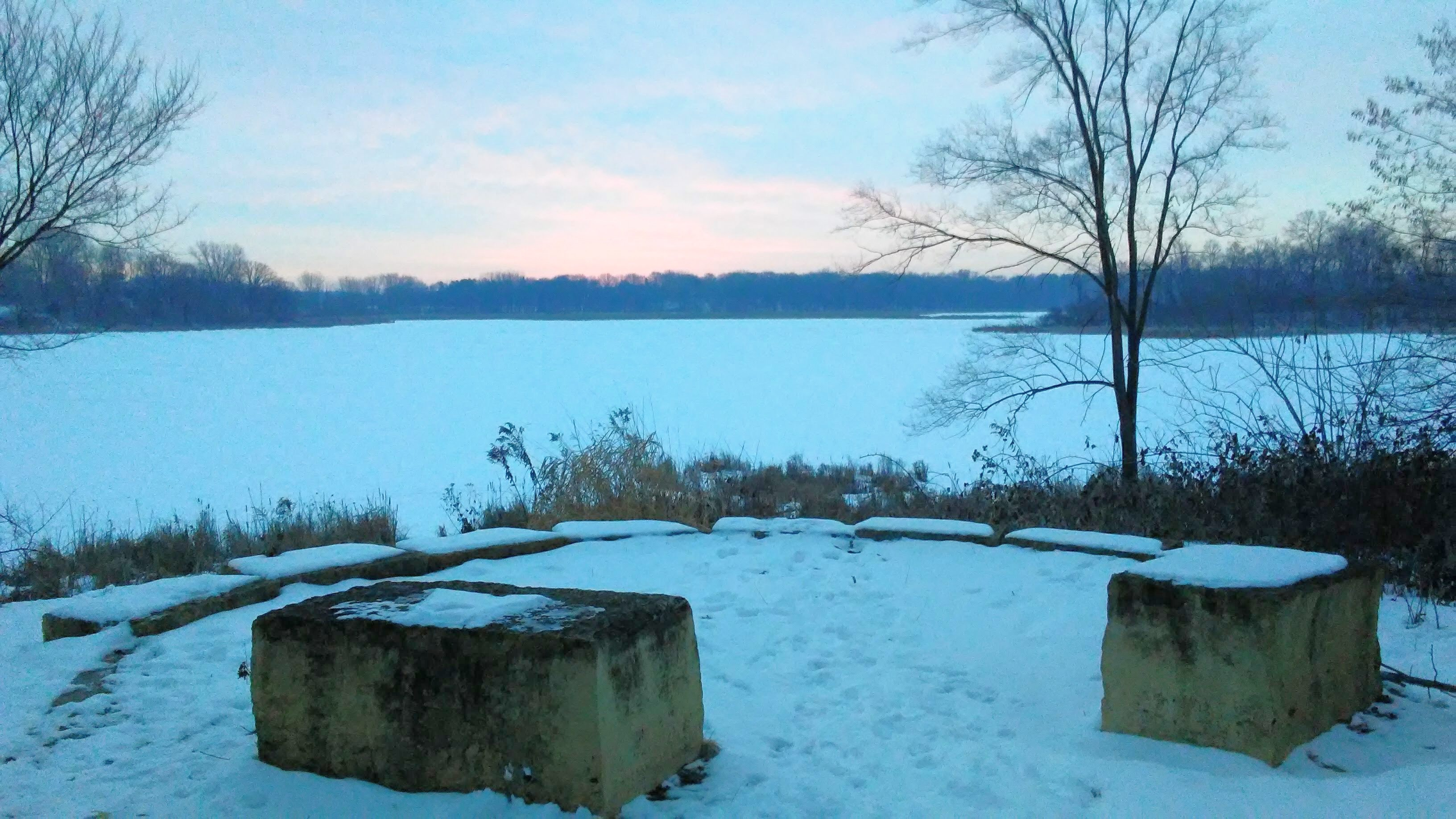 winter scene with lake and square stone seats
