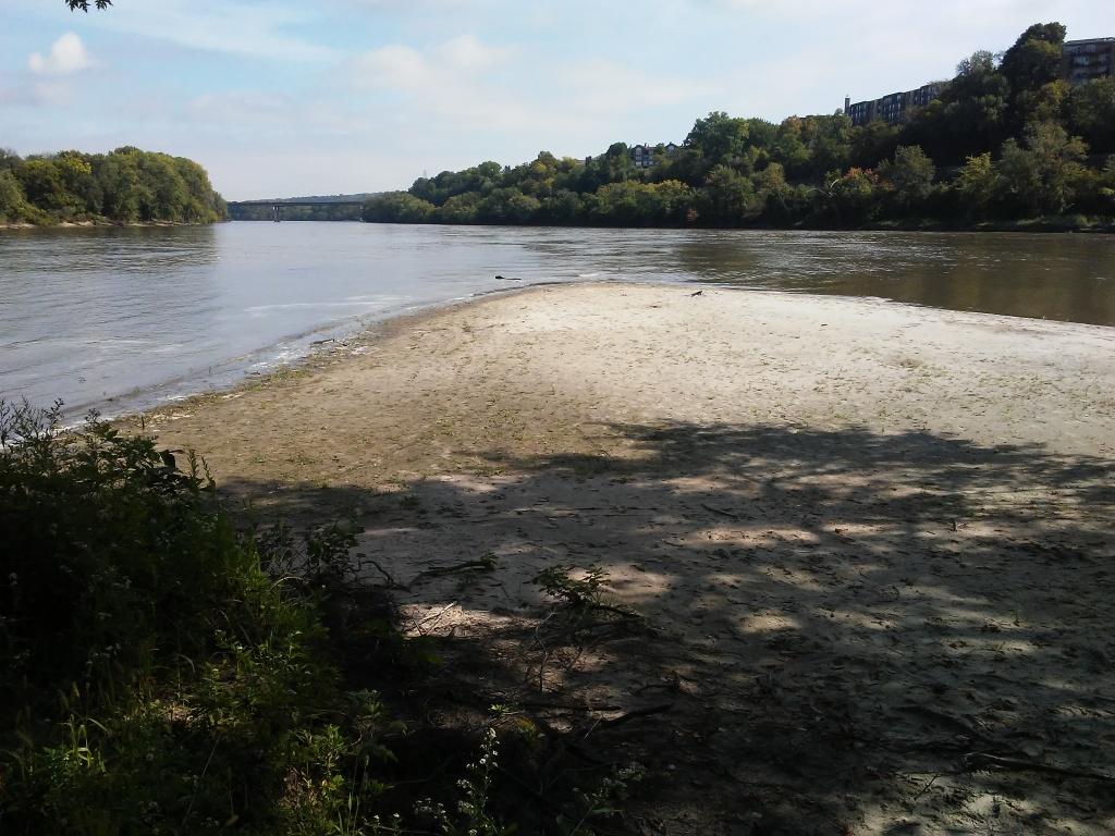 sandbar extending into a river