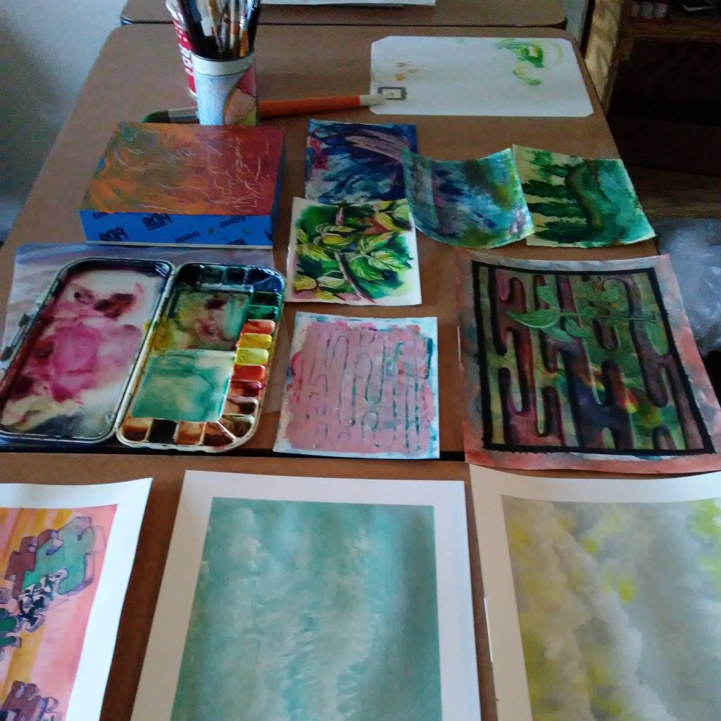 paper paintings on a table