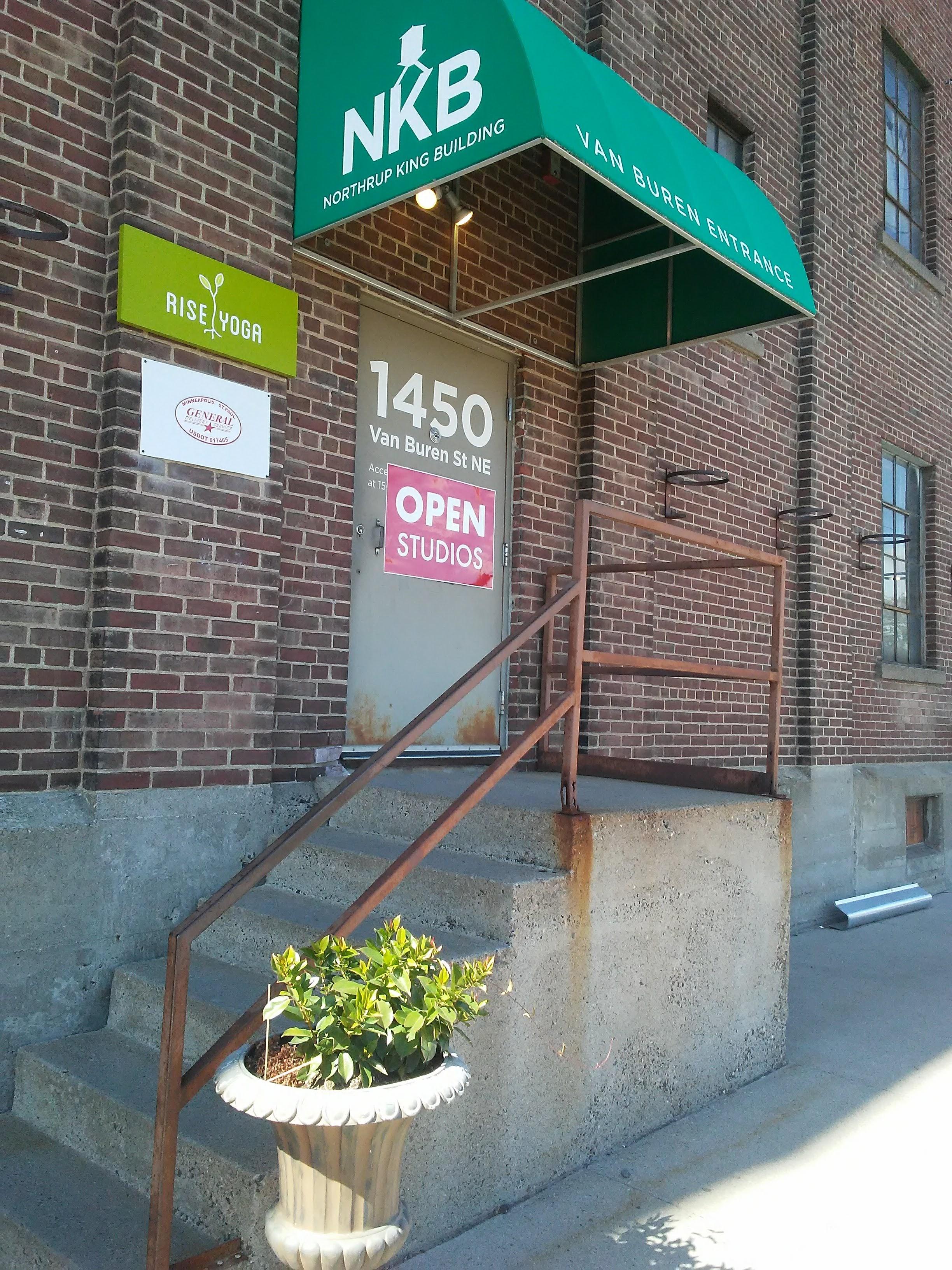 1450 Van Buren St. Minneapolis. Brick wall, steps, door, green awning.